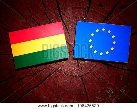 Bolivian Flag With Eu Flag On A Tree Stump Isolated
