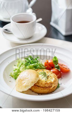 eggs benedict with fresh salad
