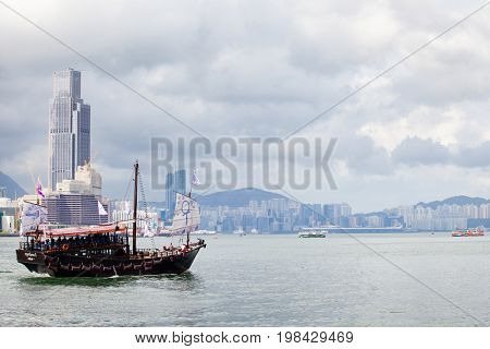 HONG KONG – JULY 18, 2017: Victoria Harbor view with Hong Kong skyline and urban skyscrapers
