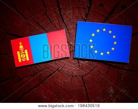Mongolian Flag With Eu Flag On A Tree Stump Isolated
