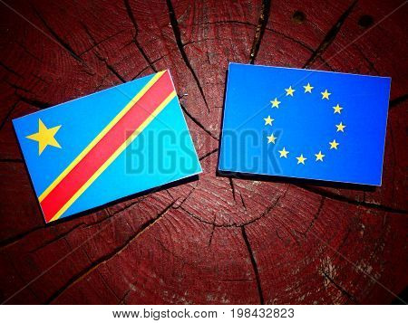Democratic Republic Of The Congo Flag With Eu Flag On A Tree Stump Isolated