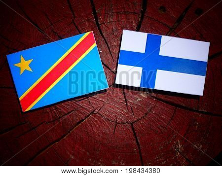 Democratic Republic Of The Congo Flag With Finnish Flag On A Tree Stump Isolated