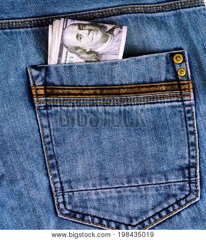 Dollars in the pocket of jeans trousers