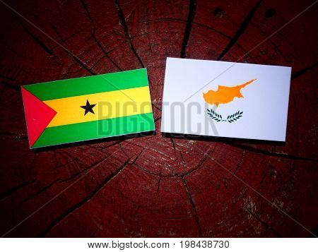 Sao Tome And Principe Flag With Cypriot Flag On A Tree Stump Isolated