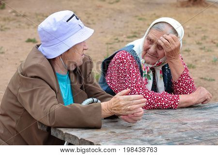 Jartcevo, Russia - August 18, 2010: Grandmothers of the pensioner are sitting at the table