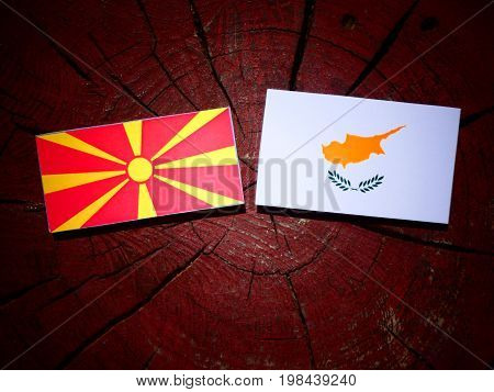 Macedonian Flag With Cypriot Flag On A Tree Stump Isolated