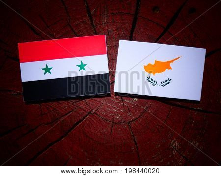 Syrian Flag With Cypriot Flag On A Tree Stump Isolated