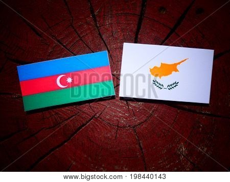 Azerbaijan Flag With Cypriot Flag On A Tree Stump Isolated