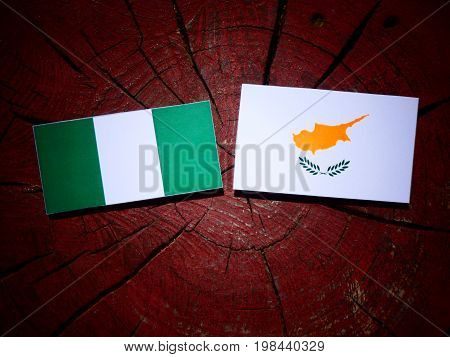 Nigerian Flag With Cypriot Flag On A Tree Stump Isolated