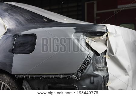 Auto body repair series: Black car after being masked before repaint