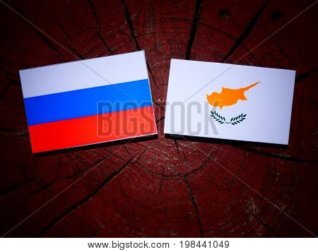 Russian Flag With Cypriot Flag On A Tree Stump Isolated