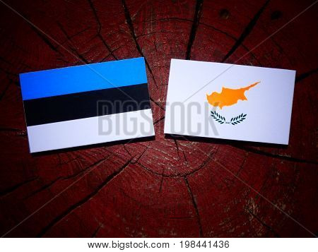 Estonian Flag With Cypriot Flag On A Tree Stump Isolated