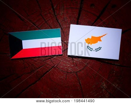 Kuwaiti Flag With Cypriot Flag On A Tree Stump Isolated