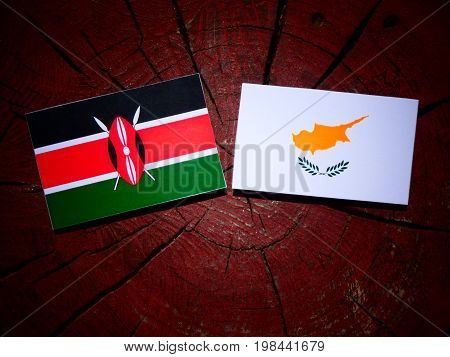 Kenyan Flag With Cypriot Flag On A Tree Stump Isolated