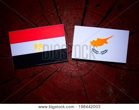 Egyptian Flag With Cypriot Flag On A Tree Stump Isolated