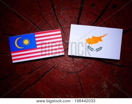 Malaysian Flag With Cypriot Flag On A Tree Stump Isolated