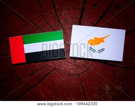 United Arab Emirates Flag With Cypriot Flag On A Tree Stump Isolated