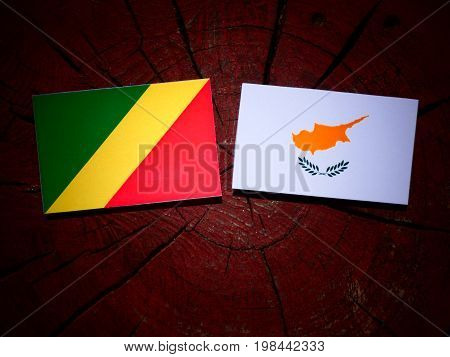 Republic Of The Congo Flag With Cypriot Flag On A Tree Stump Isolated