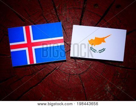 Icelandic Flag With Cypriot Flag On A Tree Stump Isolated