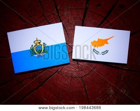 San Marino Flag With Cypriot Flag On A Tree Stump Isolated