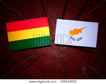 Bolivian Flag With Cypriot Flag On A Tree Stump Isolated