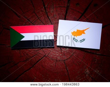 Sudan Flag With Cypriot Flag On A Tree Stump Isolated