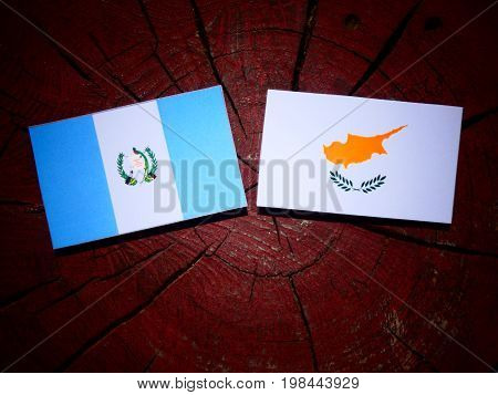 Guatemalan Flag With Cypriot Flag On A Tree Stump Isolated