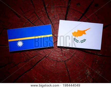 Nauru Flag With Cypriot Flag On A Tree Stump Isolated