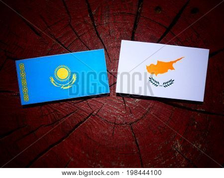 Kazakhstan Flag With Cypriot Flag On A Tree Stump Isolated