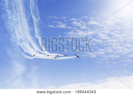Image of aerobatics team performs flight while doing maneuvers at the airshow
