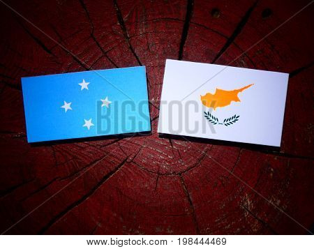 Micronesian Flag With Cypriot Flag On A Tree Stump Isolated
