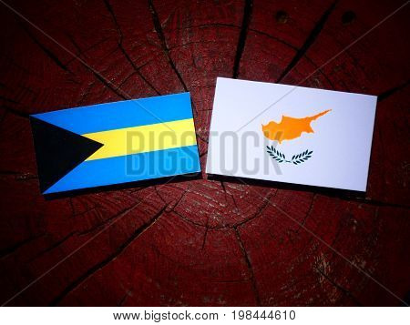 Bahamas Flag With Cypriot Flag On A Tree Stump Isolated