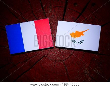French Flag With Cypriot Flag On A Tree Stump Isolated