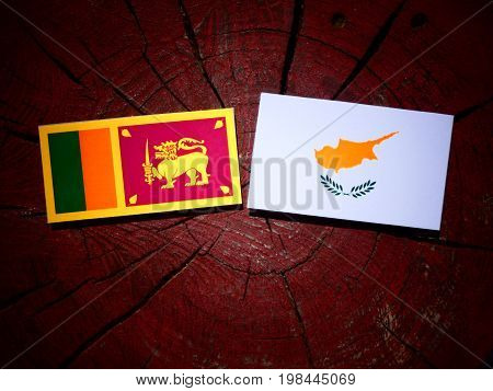 Sri Lankan Flag With Cypriot Flag On A Tree Stump Isolated