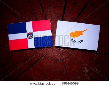 Dominican Republic Flag With Cypriot Flag On A Tree Stump Isolated