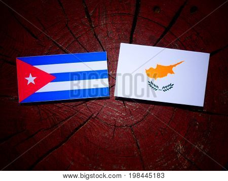 Cuban Flag With Cypriot Flag On A Tree Stump Isolated