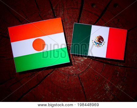 Niger Flag With Mexican Flag On A Tree Stump Isolated