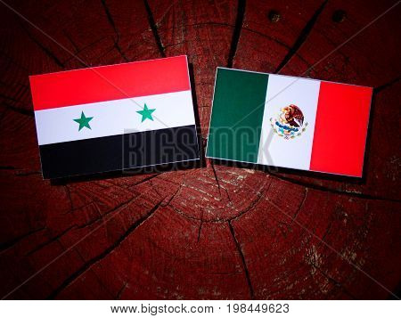 Syrian Flag With Mexican Flag On A Tree Stump Isolated