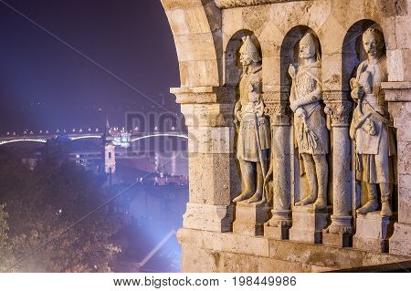 Three stone statues guarding top of stairway to Fisherman's Bastion, in Castle district, Budapest, capital of Hungary