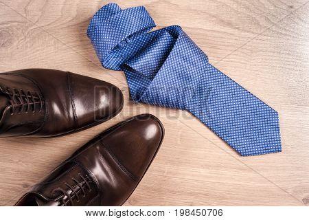 Men's Accessories Men's Shoes, Tie On A Wooden Background. Classic Men's Accessories. Top View