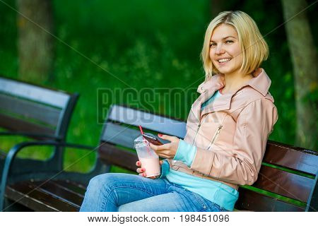Blonde With Milkshake On Bench
