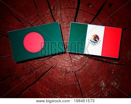 Bangladesh Flag With Mexican Flag On A Tree Stump Isolated