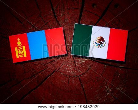 Mongolian Flag With Mexican Flag On A Tree Stump Isolated