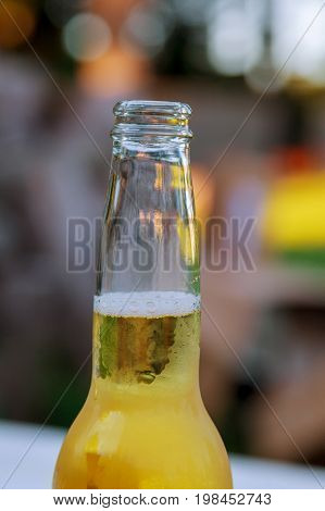 Open Bottle Of Beer On The Background Of Nature