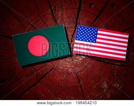Bangladesh Flag With Usa Flag On A Tree Stump Isolated