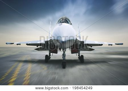 Image of jet fighter landing on the carrier deck with blur motion