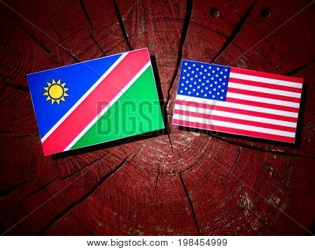 Namibian Flag With Usa Flag On A Tree Stump Isolated