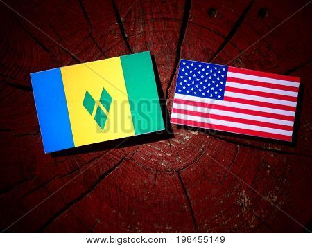 Saint Vincent And The Grenadines Flag With Usa Flag On A Tree Stump Isolated
