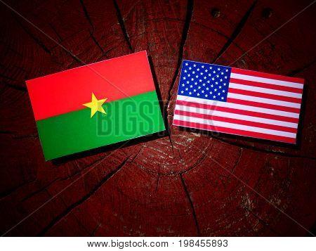 Burkina Faso Flag With Usa Flag On A Tree Stump Isolated