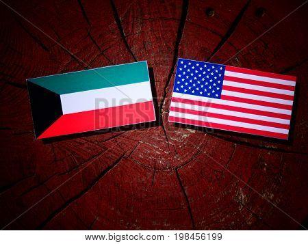 Kuwaiti Flag With Usa Flag On A Tree Stump Isolated
